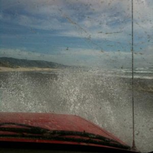 driving through the ocean waves at Sand Lake, Oregon.