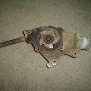 The old waterpump that came off my Jeep. I do not think this is the original. I can't get the other pipe off, I will have to buy a new one.