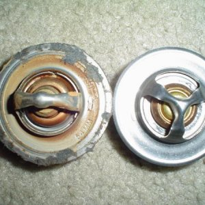 Left to right; Stock 195F thermostat, 180F 50% bigger opening thermostat.