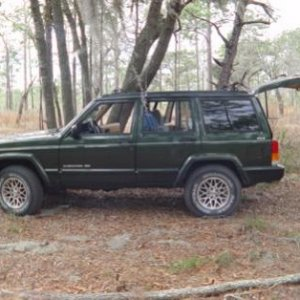 "Green Cherokee: I should never have sold this one. It had the factory ""UpCountry 2"" lift and all the steel skid plates."