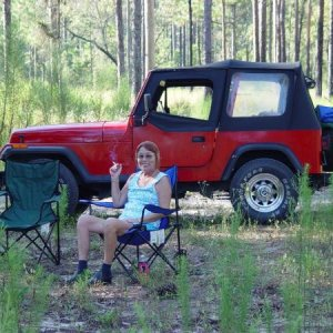 My wife Sheri enjoying some quiet time way out in the state forest. I think this was a 94 Wrangler. Four cylinder four speed. We sold it to buy the gr